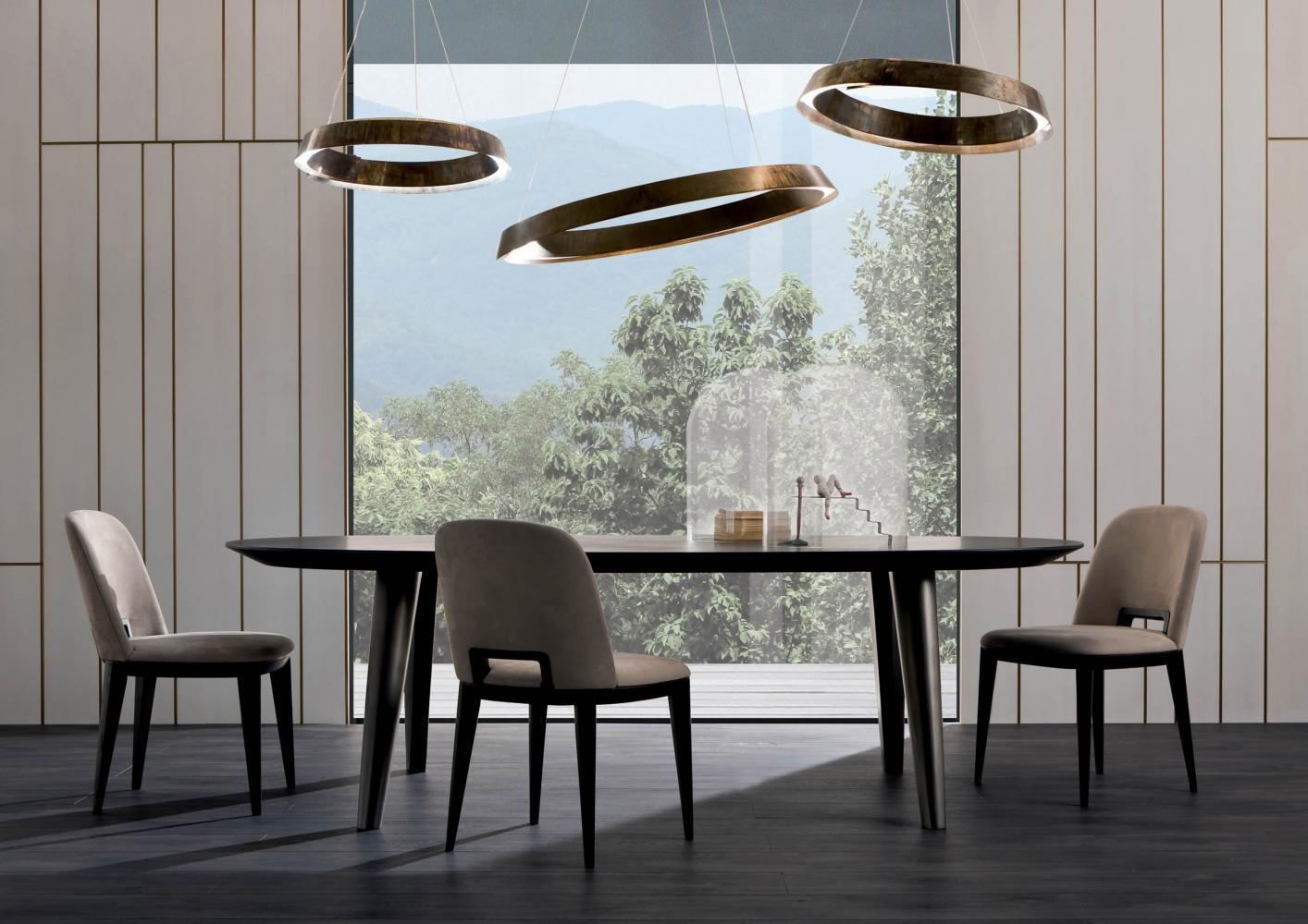 An handcrafted suspended round lighting collection made in Italy